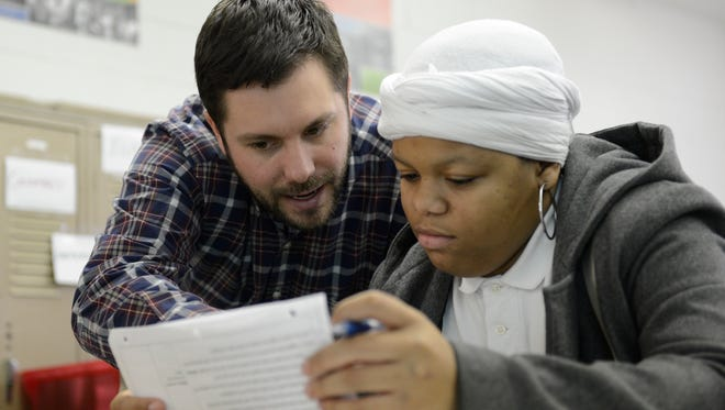 Brian Thompson works with Dajahne Hooks in 2012 at Cardoza High School in Washington, D.C., as part of the Teach for America program.
