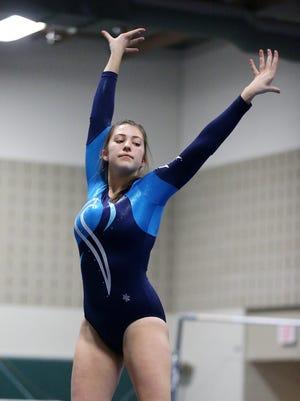 Livonia Stevenson's Jenna Burton competes on the balance beam during a meet earlier this season.