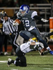 Scott's David Patrick tries to leap over Johnson Central's