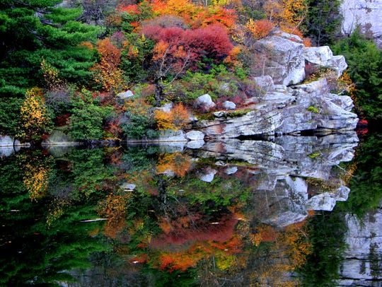 A reflection of the fall colors in the water at Minnewaska
