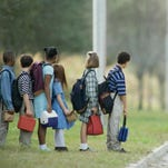 Kids waiting for the school bus.