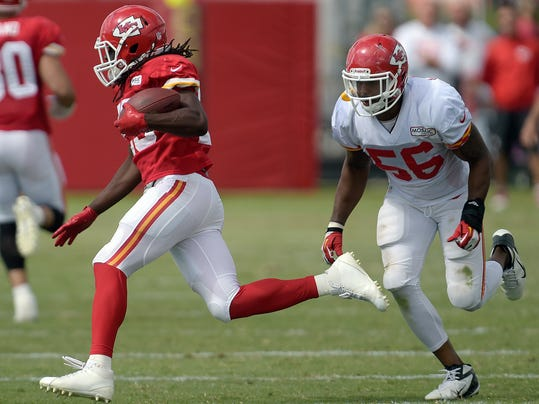 Kansas City Chiefs running back Jamaal Charles, left, tries to elude linebacker Derrick Johnson (56) during an NFL football training camp Monday, July 28, 2014, on the Missouri Western State University campus in St. Joseph. Mo. (AP Photo/The St. Joseph News-Press, Todd Weddle)
