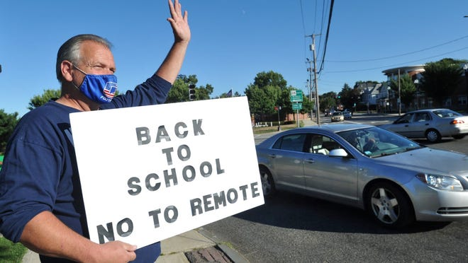 Quincy parent Tom Plooof joins a rally on Hancock Street in Quincy against the city's decision requiring remote learning for certain grades on Wednesday, Aug. 26, 2020. Tom Gorman/For The Patriot Ledger
