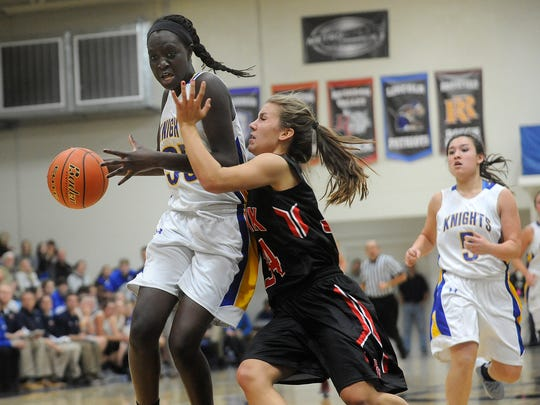 O'Gorman's #35 Sebastian Akoi drives to the basket against Brandon Valley's #34 Sydnie Buchheim during girls basketball action at O'Gorman High School in Sioux Falls, S.D., Tuesday, Dec. 15, 2015.