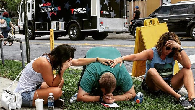 In this photo courtesy of the Instagram site of the_pixel_trappa, shows people mourning for victims of the mass shooting near the Pulse gay nightclub in Orlando, Florida, on June 12, 2016.