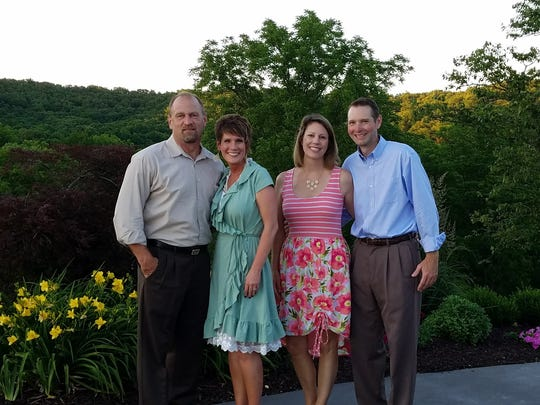 Jim and Staci Maneage, left, and Paige and Steve Galbierz,