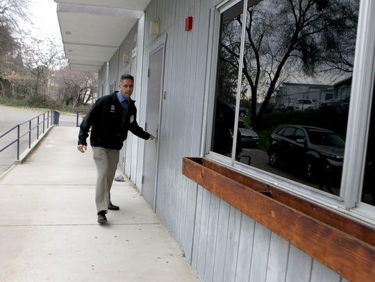 Shasta High School Principal Leo Perez checks on locked