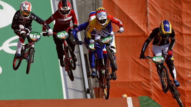 Cyclists, from right, Mariana Pajon of Colombia, Stefany Hernandez of Venezuela, Simone Christensen of Denmark and Alise Post of the United States compete in the women's BMX cycling semifinals.