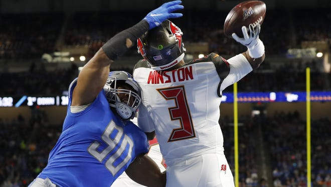 FILE - Tampa Bay Buccaneers quarterback Jameis Winston (3) throws before being hit by Detroit Lions defensive end Trey Flowers (90) during the first half of an NFL football game, Sunday, Dec. 15, 2019, in Detroit. NFL teams can always use more pass rushers, as evidenced by the NFC North where all four teams have spent big to acquire them over the last three years.