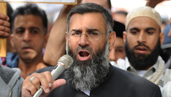 Muslim cleric Anjem Choudary speaks to a group of demonstrators protesting in 2012.