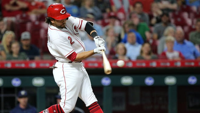 Cincinnati Reds shortstop Alex Blandino (2) hits his first career home run in the eighth inning during a National League baseball game between the Milwaukee Brewers and the Cincinnati Reds, Tuesday, May 1, 2018, at Great American Ball Park in Cincinnati. Milwaukee won 7-6