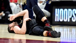 Cleveland Cavaliers center Kevin Love reacts after