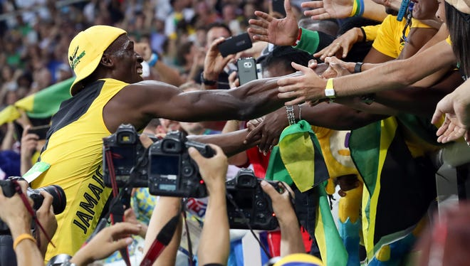 Usain Bolt (JAM) wins the men's 100 final during the track and field competition in the Rio 2016 Summer Olympic Games at Estadio Olimpico Joao Havelange.