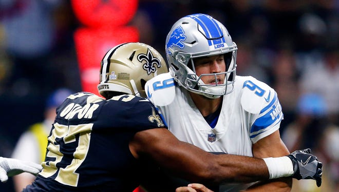Lions QB Matthew Stafford fumbles as he is hit by Saints DE Alex Okafor, causing a fumble recovered in the end zone for a Saints touchdown in the first quarter in New Orleans, Sunday, Oct. 15, 2017.