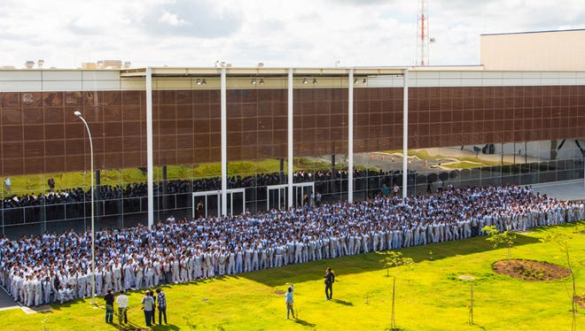 Employees gather for grand opening of Fiat Chrysler's Jeep plant in Brazil.