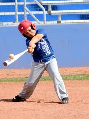 Tanner Collins, 9, hits the ball during the Cavemen baseball camp Tuesday at Bob Forrest Youth Sports Complex.