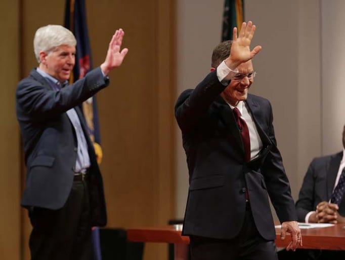 Republican Gov. Rick Snyder, left and  Democratic challenger