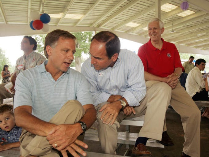 Bill Haslam, left, Zach Wamp, center, and Bill Gibbons wait to be announced as the Davidson County Republican Party holds a picnic for the gubernatorial candidates at Centennial Park.