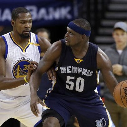 Memphis Grizzlies' Zach Randolph (50) is defended by