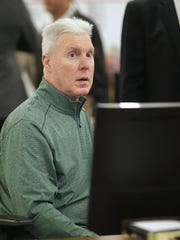 Green Bay Packers general manager Ted Thompson inside the draft room Thursday night at Lambeau Field.
