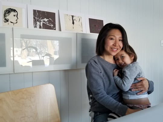 Angie Lee holds her daughter Maxine.