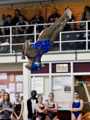 West York's Trinity Thomas performs a dive in a YAIAA
