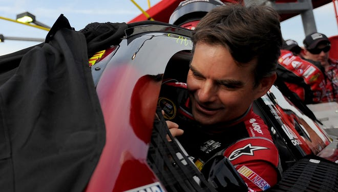 Jeff Gordon climbs into his car before the Coca-Cola 600 at Charlotte Motor Speedway on May 25.