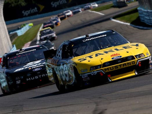 Marcos Ambrose, driver of the #09 Stanley Ford, leads a pack of cars during the NASCAR Nationwide Zippo 200 at The Glen.