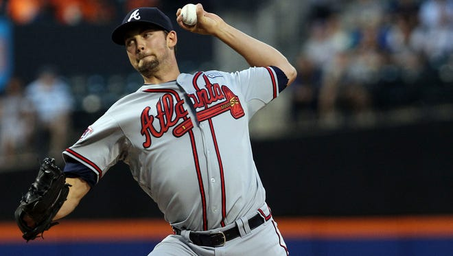 Atlanta Braves starting pitcher Mike Minor delivers a pitch against the New York Mets in the first inning at Citi Field.