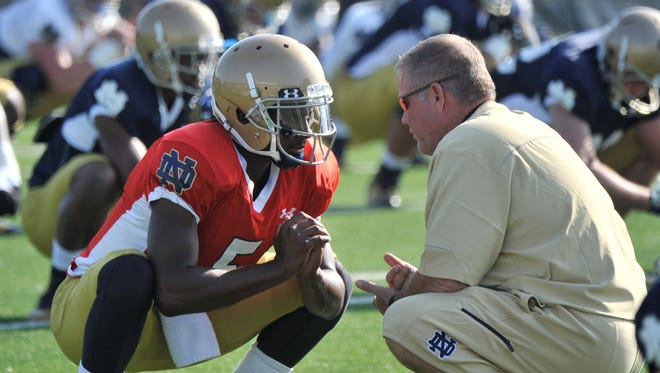 Notre Dame coach Brian Kelly, right, talks with quarterback Everett Golson during practice Saturday Aug. 9, 2014 in South Bend, Ind. Notre Dame opens the season against Rice at home Saturday Aug. 30.