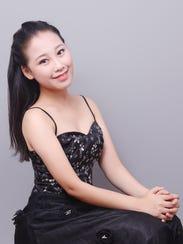 Mei LI, was born in Henan, China, and began her piano