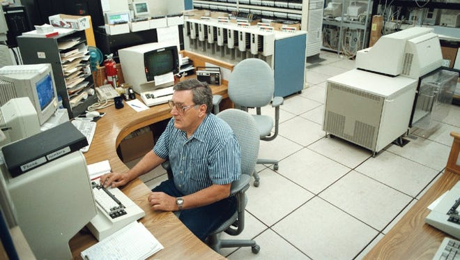 Computer operator Bob Krupicka works with the computer system in the computer room at the Salem-Marion County Data Center in 1999. An audit in 2015 found that computers from the '90s still run some state programs.