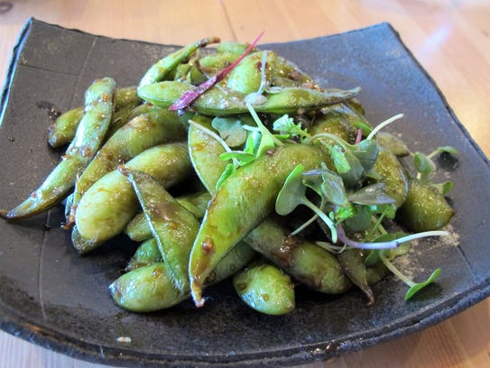 Edamame, or steamed soybeans, are among the small plates