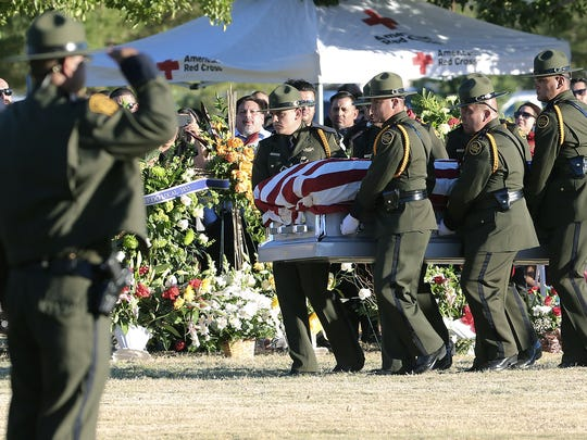 Border Patrol pall bearers carry Border Patrol agent Rogelio Martinez to a graveside service at Restlawn Cemetery Saturday, November, 25, 2017. Martinez was on patrol in the Big Bend Sector when he died in the line of duty. FBI is investigating the death.