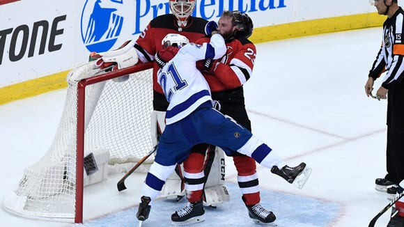 Tampa Bay Lightning center Brayden Point (21) and New Jersey Devils right wing Stefan Noesen (23) fight in the second period. The Devils defeat the Lightning 5-2 in Game 3 of Round 1 of the Stanley Cup Playoffs at the Prudential Center in Newark, NJ on Monday, April 16, 2018. The series is 2-1, Tampa Bay.