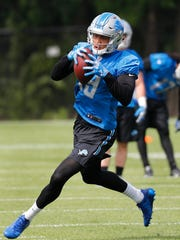 Lions rookie receiver Kenny Golladay catches a pass during practice in Allen Park on Wednesday, May 24, 2017.