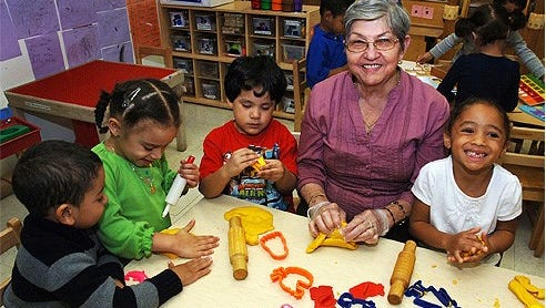 Head Start classroom volunteers read with children, share center time learning activities, play educational games, support number learning, work one-on-one writing, eat lunch with a small group and are role models to promote positive socialization.