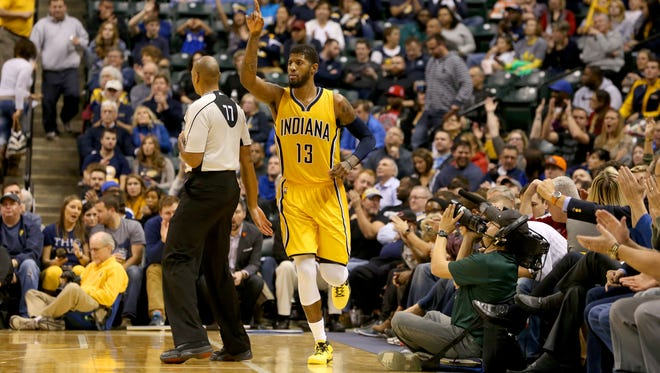 Indiana Pacers forward Paul George (13) signals to a teammate after draining a three-pointer against the Toronto Raptors at Bankers Life Fieldhouse on Dec. 14, 2015.