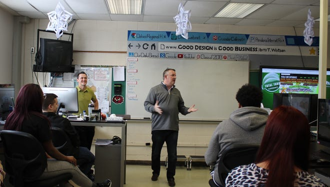 Jerry McGough (right), principal owner of Total Turf and South Jersey Sports Digest, spoke to students in the Dave Daigle's (left) Intro to Business: Careers in Sports class at Delsea Regional High School.