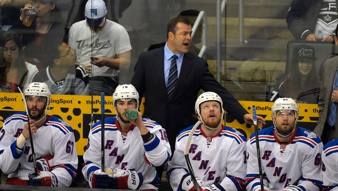 Rangers coach Alain Vigneault, top, talks to his team during the third period of Game 1 on Wednesday night in Los Angeles.