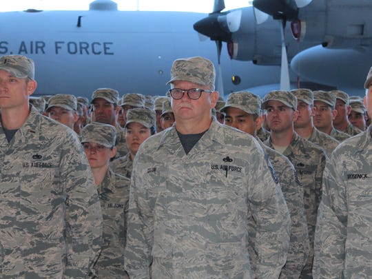 MANG airmen stand at attention during change of command