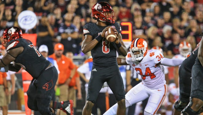 Louisville's Lamar Jackson looks to pass in the first half against Clemson. Jackson was 8-for-20 in the first half with 83 yds, one TD, and 47 rushing yds.