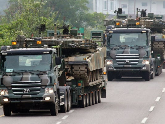 U.S., Seoul pause exercises as North threatens war