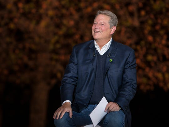 Al Gore finds a few things to smile about in the global