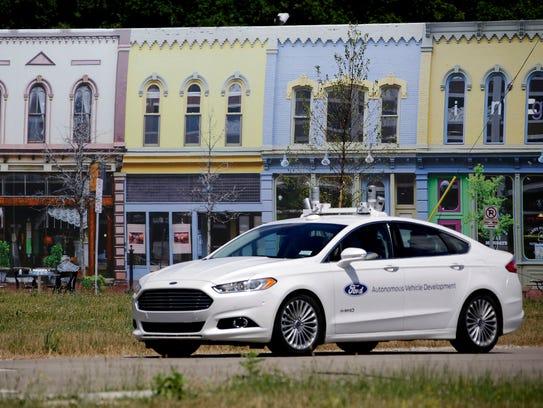 A 2015 Ford Fusion Hybrid Autonomous Vehicle travels