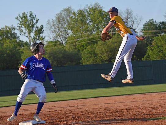 Byrd's Chris Robinson goes high as Evangel's Austin