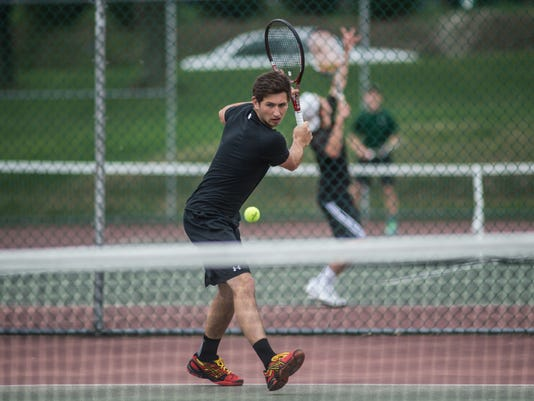 Red Lion's Sam Innerst competes in the YAIAA boys' tennis tournament at South Western High School on April 27.