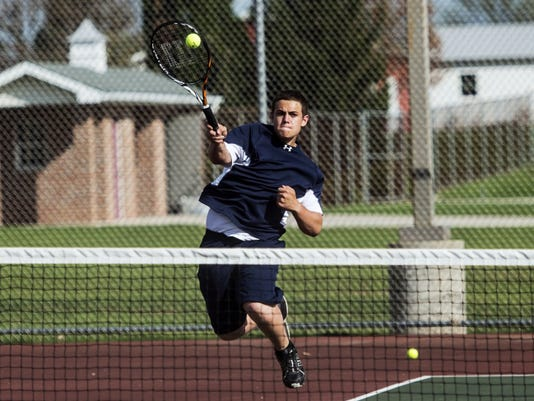 New Oxford's Justin Klunk returns a shot during a doubles match during Monday's match against Delone Catholic. Klunk and Adam Rudasill earned an 8-1 win against Delone's Paul Rath and Allen Sweeney as the Colonials swept the Squires, 7-0.