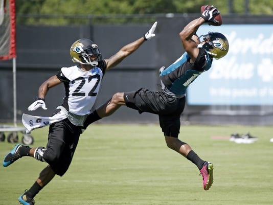 Jacksonville Jaguars wide receiver Allen Robinson, right, makes a reception as he is defended by cornerback Aaron Colvin during minicamp, on Wednesday in Jacksonville, Florida.