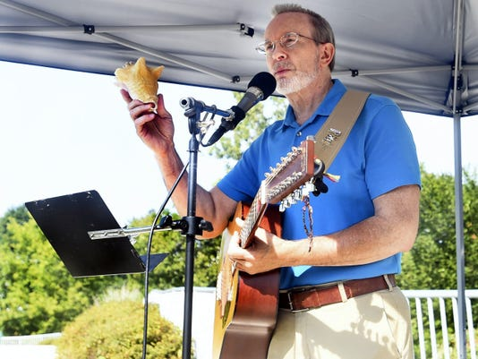 Roy Justice tells stories through music at the Franklin County Storytelling Festival on Saturday. A self-described singing historian, his performances attempt to explain how we are the way we are and how we got here today.